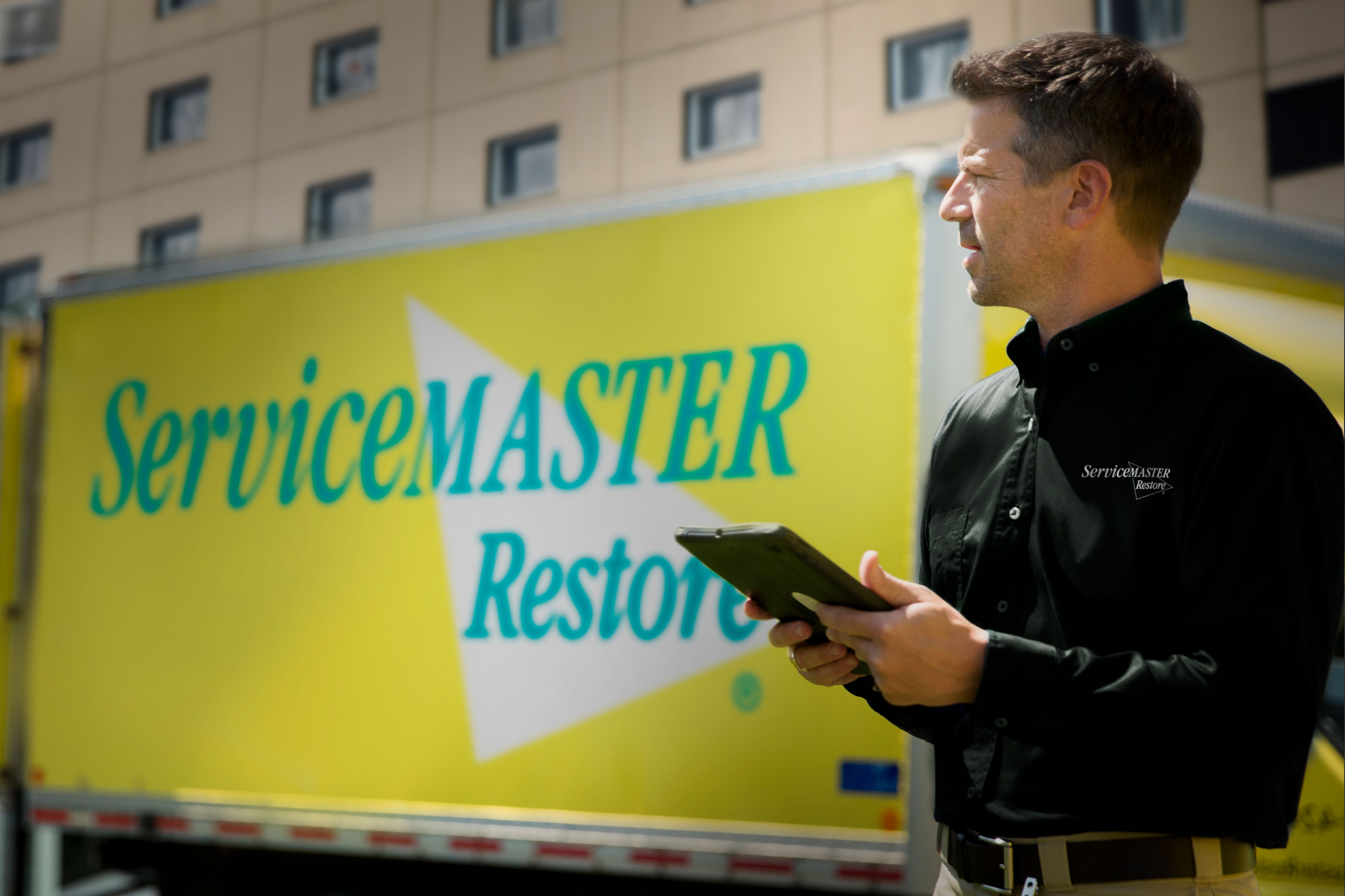 image of servicemaster tech in front of truck